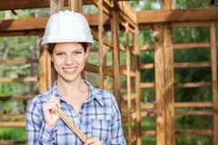 Happy Female Worker Holding Measuring Tape At Site Stock Photos
