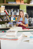 Happy Female Worker Holding Papers In Factory Stock Photos
