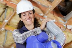 Free Happy Female Worker Holding Ventilation Pipes Royalty Free Stock Photography - 173517527
