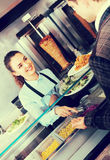 Happy female worker serving customer. With smile at shawarma place Stock Photos