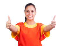 Happy female worker in uniform showing thumbs up Royalty Free Stock Image