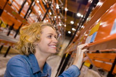 Happy female worker at warehouse Stock Photography