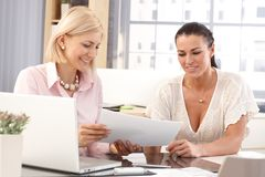 Happy female workers at business office Royalty Free Stock Photos