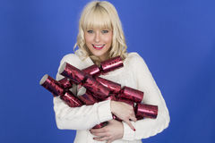 Happy Festive Young Woman Holding Christmas Crackers Stock Images