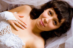 Happy fiancee. Portrait of happy beautiful fiancee holding hand on her chest Stock Images
