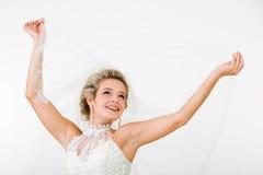 Happy fiancee. Portray of happy beautiful fiancee raising hands with veil Stock Photos