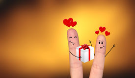 Happy finger couple in love celebrating Xmas. A happy couple in love offering gifts to each other Stock Photography
