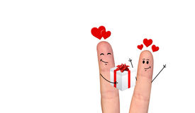 Happy finger couple in love celebrating Xmas. A happy couple in love offering gifts to each other Stock Image