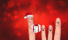 Happy finger couple in love celebrating Xmas. A happy couple in love offering gifts to each other Stock Photo