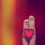 The happy finger couple in love with painted smiley. And hold heart as vintage style Stock Photos