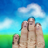 Happy finger family. On green nature background Stock Images