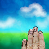 Happy finger family on green nature. Background Stock Image