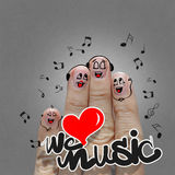 The happy finger family holding we love music. And sing a song Royalty Free Stock Photos