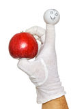 Happy finger puppet holding red apple Stock Image
