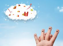 Happy finger smiley with graph cloud icons in the sky. Happy finger smiley faces on hand with graph cloud icons in the sky stock photos
