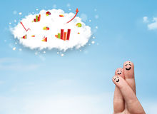Happy finger smiley with graph cloud icons in the sky Royalty Free Stock Photo