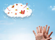 Happy finger smiley with graph cloud icons in the sky Stock Images