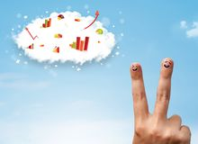 Happy finger smiley with graph cloud icons in the sky. Happy finger smiley faces on hand with graph cloud icons in the sky royalty free stock images