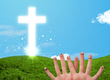 Happy finger smileys with christian religion cross Stock Images