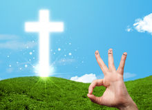 Happy finger smileys with christian religion cross Stock Photo
