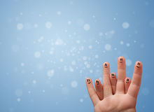 Happy finger smileys with empty blue bokeh background Royalty Free Stock Photos