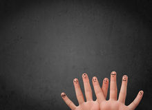 Happy finger smileys with empty copy space dark background Royalty Free Stock Photos