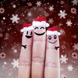 Happy finger smileys in Santa hats Stock Photos