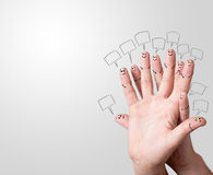 Finger smileys with speech bubbles. Stock Photo