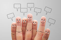 Happy finger smileys with speech bubbles on grey background Stock Photos