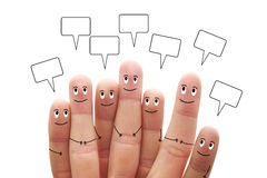 Happy finger smileys with speech bubbles on white background Royalty Free Stock Images
