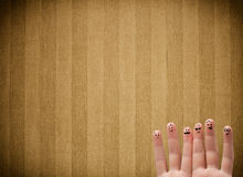 Happy finger smileys with vintage stripe wallpaper background Royalty Free Stock Photo