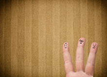 Happy finger smileys with vintage stripe wallpaper background Stock Image