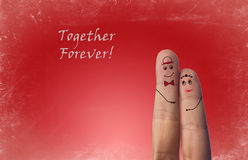 Happy Fingers Couple In Love With Painted Smiley. On red vintage background stock photography