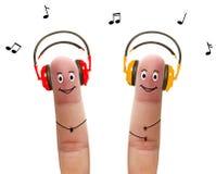Happy fingers in headphones Stock Photos