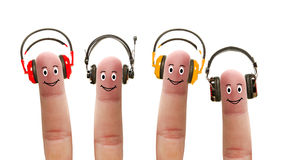 Happy fingers in headphones Royalty Free Stock Photos
