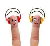 Happy fingers in headphones Stock Image