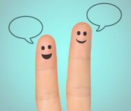 Happy fingers with speech bubbles. On turquoise background, social media concept Stock Image