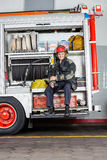 Happy Fireman Holding Coffee Mug In Truck Royalty Free Stock Photo