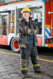 Happy Fireman Standing Against Truck Stock Image