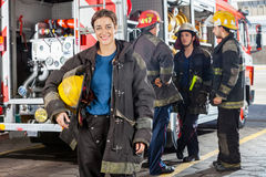 Happy Firewoman With Colleagues Discussing By Royalty Free Stock Photos