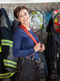Happy Firewoman Standing At Fire Station Stock Photo