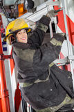 Happy Firewoman Standing On Truck At Fire Station Stock Images