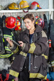 Happy Firewoman Using Digital Tablet At Fire Station Royalty Free Stock Images