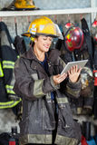 Happy Firewoman Using Digital Tablet Royalty Free Stock Images