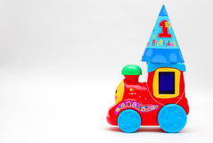Happy First Birthday. Image of a 1st birthday hat on a toy train Royalty Free Stock Photo