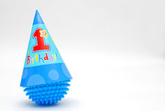 Happy First Birthday. Image of a first birthday hat on a toy ball Royalty Free Stock Images