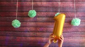 Happy first birthday, golden air balloons with number one, anniversary celebration. With decorations stock video