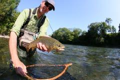 Happy fisherman caught river fish Stock Image
