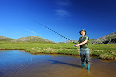Happy fisherman fishing in Mavrovo Royalty Free Stock Images