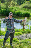Happy Fisherman with his pike Royalty Free Stock Photos